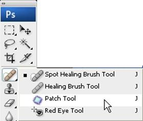 Select the Patch Tool (J), which is hidden under the Spot Healing Brush too